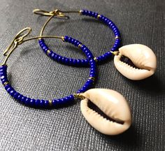 A personal favorite from my Etsy shop https://www.etsy.com/listing/480530792/cobalt-beaded-hoops-with-cowrie-shells