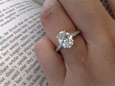 oval solitaire engagement ring, eternity band.