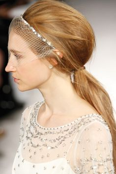 A cage veil headband adds bridal flair to your big day pony.