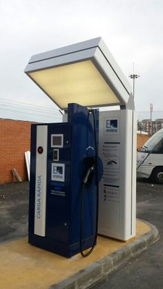 Fasto charger by Endesa with EQC in Malaga Electric Vehicle, Electric Cars, Electric Station, Kiosk, Malaga, Landline Phone, Charger, Locker Storage, Design