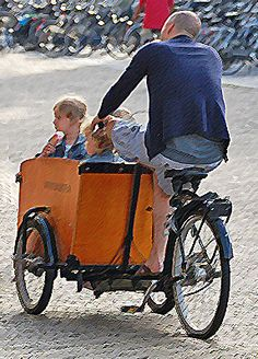 Dutch bicycles come in all shapes and sizes, and can be seen transporting, children, pets, furniture, etc. This was taken in Delft, South Holland