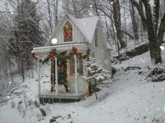 sweet cottage in the snow, why cant we do this with the old storage building and put it by the pond for our fishing stuff