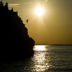 Peter Calak Leap of faith Cliff Diving in Tobermory, ON.