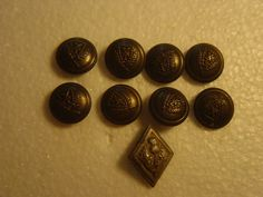 small collection of brass military buttons by alomartesantiques
