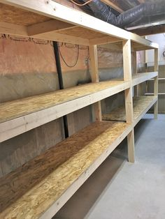 DIY Storage: Easy Extra Space Storage Shelves - Making Things is Awesome - - Quick and easy extra space storage shelves tutorial, that you can make alone! Create the storage room of your dreams, with super sturdy DIY storage! Wooden Garage Shelves, Basement Storage Shelves, Garage Shelving, Building Garage Shelves, Pallet Shelves, Storage Room, Pallet Benches, Bedroom Shelves, Pallet Cabinet