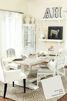 Isn't this all-white dining room gorgeous? We used easycare fabrics, off-white walls (in Benjamin Moore's Silver Satin), and white sheer drapery to create a space that feels serene.