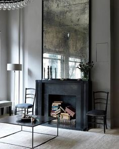 This modern fireplace and tarnished mirror make for quite the look. Do you like it? Yes, or no? #DesignDebate