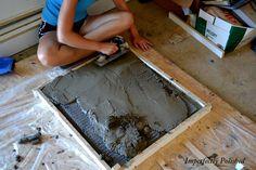 DIY concrete countertop. Quickcrete makes a countertop mix. expensive, but has additives.