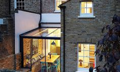 "Here's a wonderful way to combine old with new. London-based HÛT Architecture refurbished and extended this Victorian home in London with a ""jewel-like glass box"" that houses a new dining room. The architects made sure to keep the building's original features and Victorian aesthetic, while making it more suitable for a modern lifestyle, and the result is delightful."