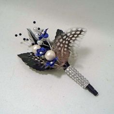 Blue and guinea feather boutonniere