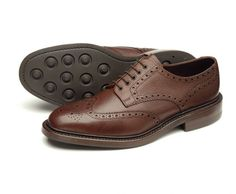 Premium heavy country Derby brogue, Badminton is available in Brown, and Dark Brown grain leathers, and features a Dainite rubber sole for greater longevity and grip. Badminton is made in England.