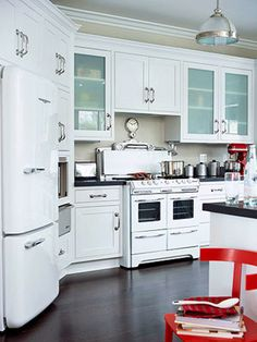 all white cabs, dark tops, glass inserts, light neutral paint, white appliances, makes for open, not oppressive in small space
