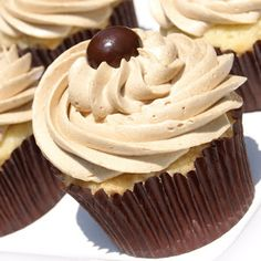 Fluffy & delicious vanilla cupcakes with the BEST coffee buttercream frosting.  A double sweet treat, for sure.