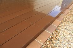Eco Deck bamboo composite decking boards 137mm wide over Spantec Boxspan steel deck frame.