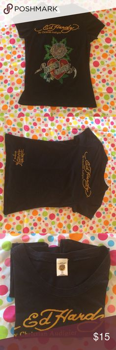 ED HaRDY t-shirt This is a super cute, never worn Ed HArdy tshirt. Has Ed Hardy by Christain Audigier on front along with a Rose, Heart bling front. The banners say Eternal Love! The back has Ed Hardy across top and bottom left DON.ED Hardy designs. Ed Hardy Tops Tees - Short Sleeve