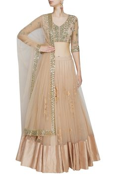 This set features a peach lehenga in net base appliqued with cream thread floral embroidery all over the front and back and criss cross sequins border around th