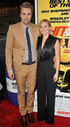 Kristen Bell 5'1 knows how to dress taller with husband Dax Shepard 6'2 #happycouple Deep V-neckline, single color outfit, straight leg floor length trousers which conceal stilettos lengthen petites.