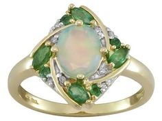.50ct Ethiopian Opal With .29ctw Emerald And .03ctw White Diamond Accents 10k Yellow Gold Ring