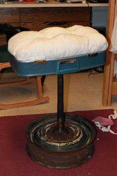 suitcase chair made out of suitcase, bed sheer, wool, thread, and axle, wheel, saw blade and lug nuts. sounds like a bad ass chair for the barn, even better with a recycle car seat