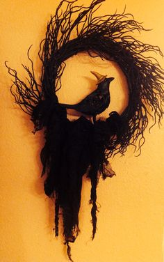 Halloween twig wreath with black gauze and lace tied on and raven wired in.