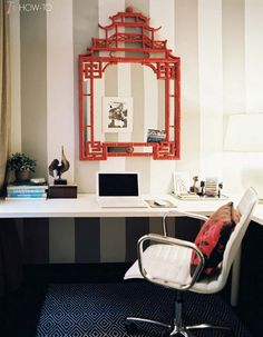 red Chinoiserie-style mirror, the Lonny offices