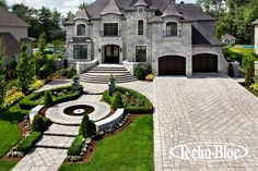Love the paving and landscaping for the front of this estate