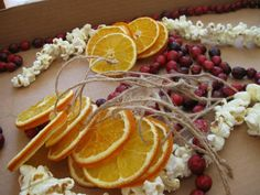 I grew up with my mother teaching me how to string popcorn, I never tried cranberries or oranges...hmmm