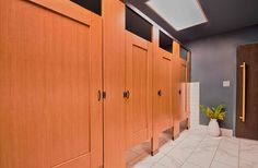 Ironwood Manufacturing laminate toilet partitions and captured panel bathroom doors. Clean, traditional custom look for a public restroom. Bathroom Stall, Bathroom Doors, Bathroom Ideas, Choir Room, National Building Museum, Bathroom Partitions, Toilet, Public Restrooms, Garage Doors