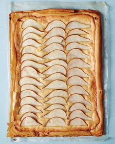 Instead of using pastry dough as the base of this tart, we stacked sheets of phyllo to create a crisp crust that is still sturdy enough to support a nut-and-fruit topping. For a different flavor profile, use skinned toasted hazelnuts in place of almonds, and apples instead of pears.