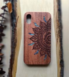 iPhone case with half mandala design is engraved on Cherry, Rosewood, and Black painted Maple wood using Abalone inlay. It can be personalized with your writing, name etc. with no extra cost. Ipod Cases, Cute Phone Cases, Iphone Phone Cases, Painted Bamboo, Painted Wood, Carved Wood, Mandala Symbols, Design Mandala, Wooden Phone Case