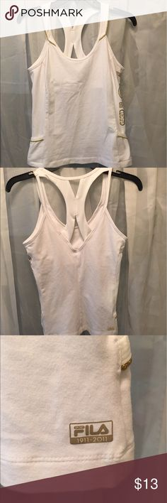 Medium FILA Tanktop Medium FILA Tanktop. White fabrics with gold lettering and embellishments. In great condition and comes from a smoke free home. Fila Tops Tank Tops