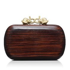 """I have been biding my time waiting for this wooden elephant closure clutch to go on sale, well it is on sale! Time to stampede on over to @toryburch  to…"""