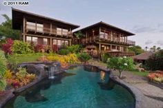 Lower level also has a covered lanai with small outdoor kitchen only steps from a stunning salt water pool and spa.