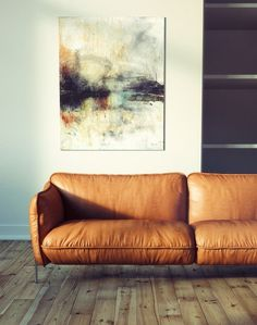 statement abstract art, camel leather sofa couch --- modern bohemian boho interior design / vintage and mod mix with nature, wood-tones and bright accent colors / anthropologie-inspired chic mid-century home decor