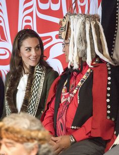 The Duchess of Cambridge watches a cultural performance from around 30 local children at the Haida Heritage Centre