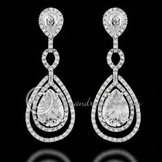 Layers of small round cubic zirconia surround a sparkly teardrop jewel in these classic bridal earrings. These CZ earrings are perfect for any special occasion! Post back, 2 inches long and .75 inches