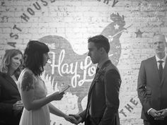 Bride and groom holding hands, reciting emotional vows. Niagara Oast House intimate Wedding Ceremony in the Hay Loft. Black and white photography. Niagara On The Lake Wedding  @oasthousebeer  #JoshBellinghamPhotography