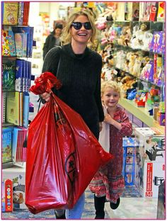 4fc02353aa Rebecca Gayheart Takes Her Daughter Shopping For Toys