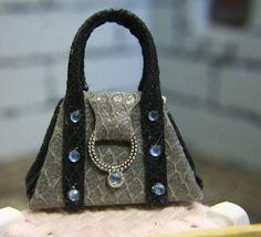 Handmade miniature handbag.