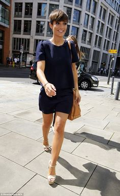 Cute get up: Frankie switched her colourful playsuit for a chic navy day dress as she exited the studios
