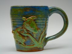 Handmade wheel thrown stoneware Mug with decorative Turtles, Microwave Dishwasher safe..Very durable..doesnt like being bounced off top of car