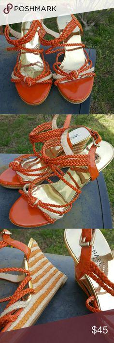 Michael Kors Rope Ankle Strap Wedges Excellent Condition 9/10. Worn once.  Orange and Cream rope straps accent these beautiful wedges. Coordinated orange and cream heels. Size 8 Michael Kors Shoes Wedges