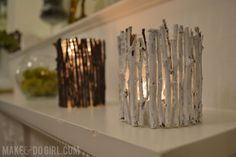 Glue sticks to an old food jar for a rustic candle holder