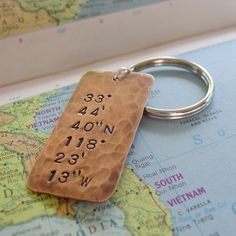 Longitude Latitude Keychain Custom Hand Stamped Location Coordinates Personalized in Hammered Copper, Anniversary, Wedding, Mens Gift. $18.00, via Etsy.