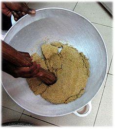Thièré millet couscous 6. breaking steamed clump apart.jpg