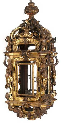 This lantern, 1570-1600, probably hung in the portego of a Venetian palace, the large, first floor room used for grand entertainments such as weddings or dances. Its opulent carving in the mannerist style would have combined with other gilded and painted woodwork, such as picture frames or ceiling beams, to present a magnificent effect to visitors. It is likely that the lantern was originally glazed.