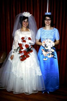 1966 The bouquets look like they are upside down. Must have been the style back then.