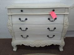 $189 - This Bombay style chest has ornate detailing, paw feet and original metal hardware. It has been painted a creamy white and a tinted wax has been hand applied. ***** In Booth D10 at Main Street Antique Mall 7260 E Main St (east of Power RD on MAIN STREET) Mesa Az 85207 **** Open 7 days a week 10:00AM-5:30PM **** Call for more information 480 924 1122 **** We Accept cash, debit, VISA, Mastercard, Discover or American Express