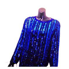 """Three Flaggs Sequin 100% Silk Blouse Perfect for the holidays! Keyhole closure and heavy. Sheer material lining in black. Minor snag on right wrist (photo 3) but not noticeable. Measurements bust-40"""", waist-40"""", arm length-15.5"""" (armpit to wrist), length-25"""" and arm width-8"""" (shoulder to armpit). Vintage Tops Blouses"""