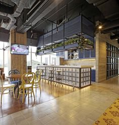 Image 6 of 38 from gallery of Jakarta Praise Community Church / Sidharta Architect. Photograph by Fernando Gomulya Bar Table And Stools, Pub Table Sets, Bar Tables, Bar Stool, Outdoor Patio Bar Sets, Outdoor Furniture Sets, Visual Merchandising, Office Break Room, Pub Set